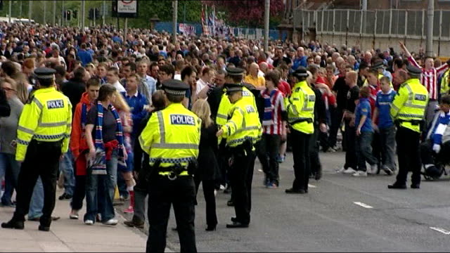 scottish parliament passes antisectarianism laws file glasgow ext various shots of groups of rangers and celtic fans arriving at stadium and chanting... - turnstile stock videos & royalty-free footage