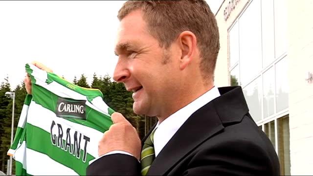 Celtic Peter Grant unveiled as First Team Coach SCOTLAND Glasgow Parkhead Celtic Park EXT Peter Grant holds up Celtic shirt for photographers Closeup...