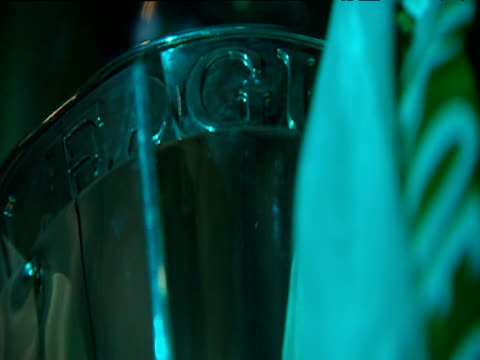 scottish premier league trophy revolving on plinth trophy adorned with green and white ribbons glasgow celtic football club celtic park parkhead... - sockel stock-videos und b-roll-filmmaterial