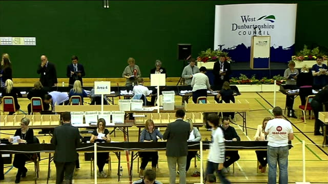 ITV News Special Clean Feed 2145 2300 West Dunbartonshire INT People counting votes in count collection centre