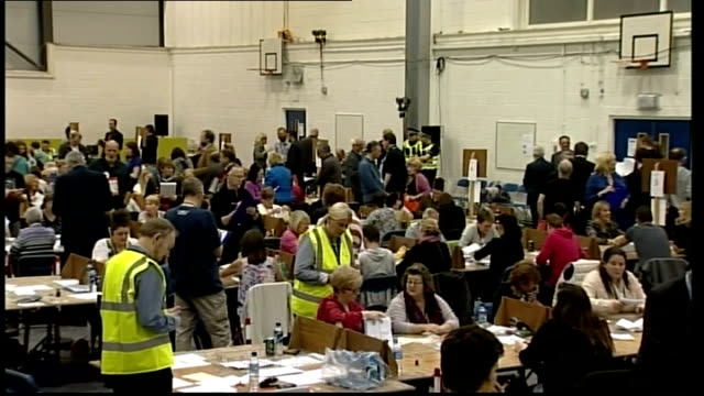 ITV News Special Clean Feed 2145 2300 West Lothian People counting ballot papers in count collection centre East Ayrshire People at tables counting...