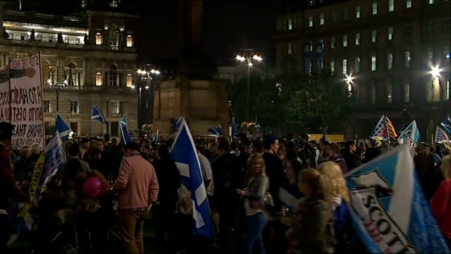 ITV News Special Clean Feed 2300 0000 Glasgow George Square **Music heard intermittently SOT** People waving saltire flags