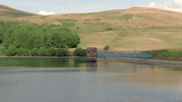 scottish reservoir after a prolonged spell of dry weather - johnfscott video stock e b–roll