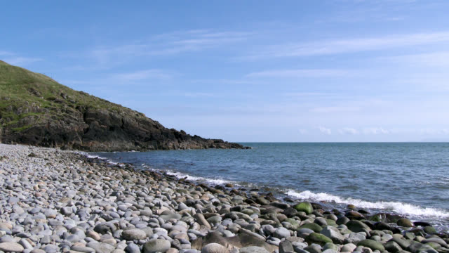 scottish rocky beach in dumfries and galloway during summer - galloway scotland stock videos & royalty-free footage