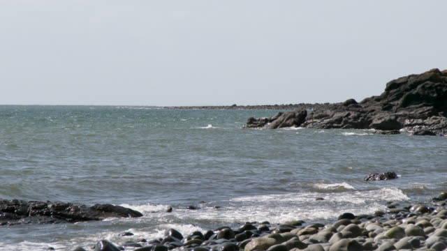 Scottish rocky beach in Dumfries and Galloway during summer