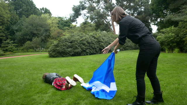 scottish siblings play with the scottish flag. - scottish flag stock videos & royalty-free footage