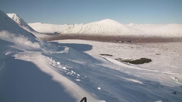 scottish ski resorts enjoy best snow in a decade but only locals can enjoy; scotland: highlands: glencoe mountain resort: ext wide shot of snow... - tourist resort stock videos & royalty-free footage