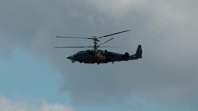 Scout-Attack Helicopter Flying Over