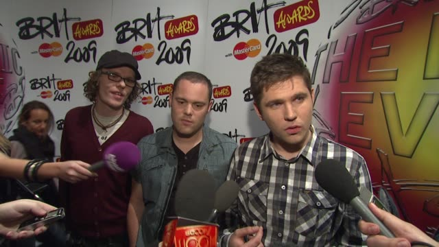 scouting for girls on what outrageous thing they would do being nominated on preforming live tonight at the uk the brit awards nominations media run... - shock tactics stock videos and b-roll footage