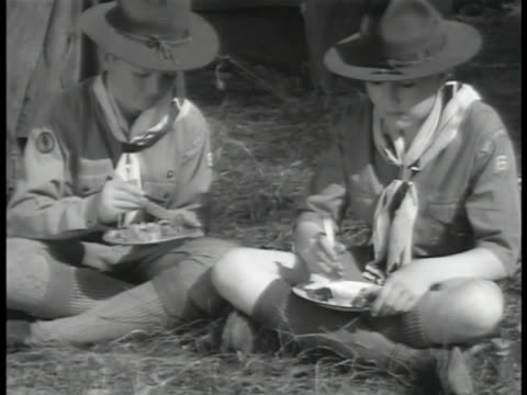 scouts cooking over campfire eating food outside ws scouts rowing canoes beating out bush fire ms boy scout using drill press in workshop leadership... - boy scouts of america stock videos and b-roll footage