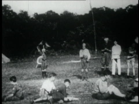 1920 montage scouts eating, swimming, and diving at an indian reservation / united states - native american reservation stock videos & royalty-free footage