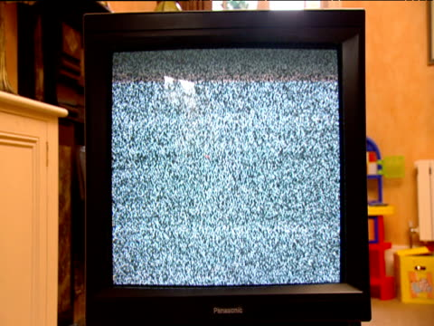 Scrambled television screen in living room