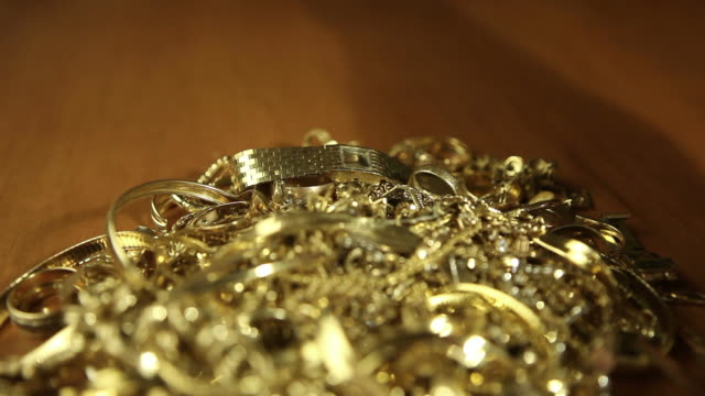 Scrap Gold Pile Exchanged for Money