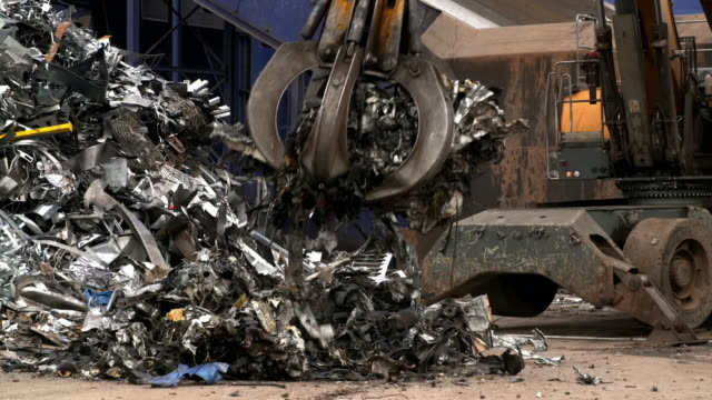 "scrap metal is processed at a recycling centre - ""bbc universal"" stock videos & royalty-free footage"