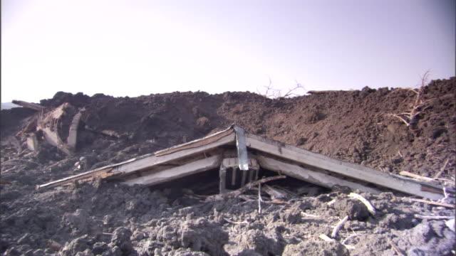 scrap metal lies among dirt piles. - littering stock videos & royalty-free footage