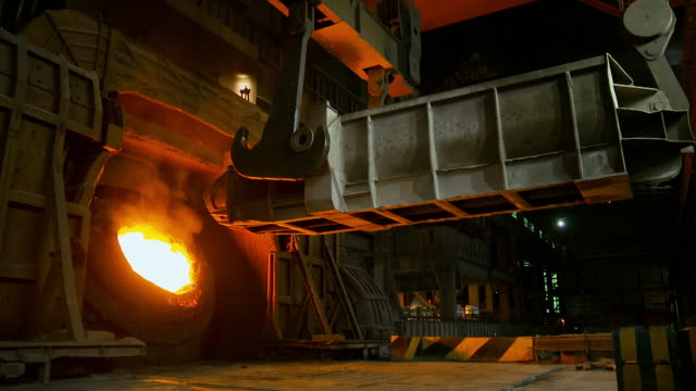 scrap metal recycled in furnace at steelworks - furnace stock videos & royalty-free footage