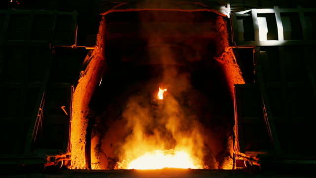 scrap metal recycled in furnace at steelworks - metal industry stock videos & royalty-free footage