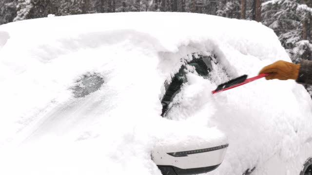 scraping snow off the car windows in winter - windshield stock videos & royalty-free footage
