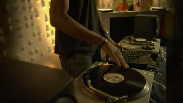 stockvideo's en b-roll-footage met ms pan dj scratching record and working mixer/ los angeles, california - hiphop