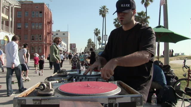 ms, dj scratching records at street market on promenade along beach, venice, los angeles, california, usa - performer stock videos and b-roll footage
