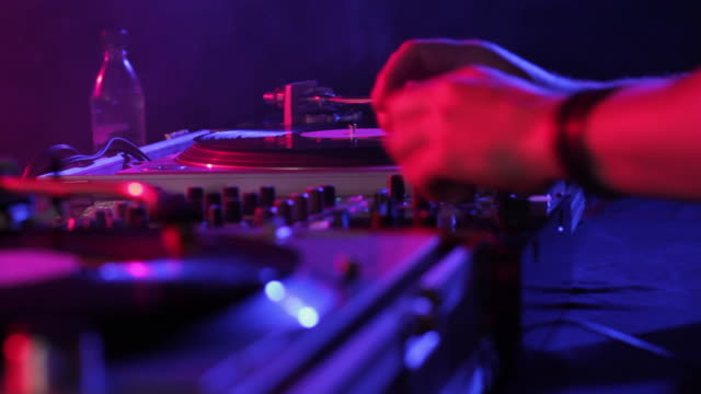 cu selective focus dj scratching records in nightclub, view of hand / london, united kingdom - knob stock videos & royalty-free footage
