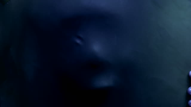 screaming human face pressing through fabric as horror background - halloween wallpaper stock videos and b-roll footage