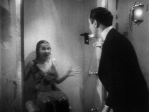 b/w 1936 screaming wet woman in shower chasing man / feature - 1936 stock videos and b-roll footage