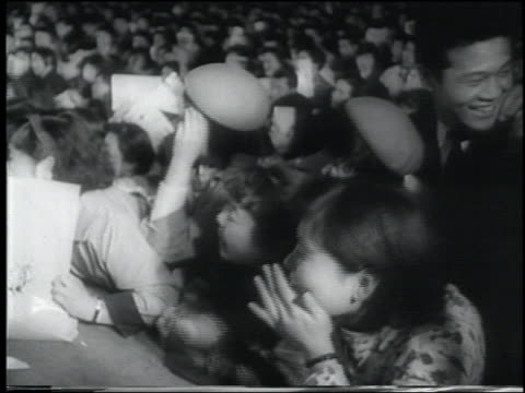 b/w 1958 newsreel screaming young japanese women at rock concert / tokyo - 1958 stock videos & royalty-free footage