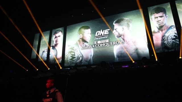 a screen displays advertisement for the one kings conquerors event at the venetian macao in macau on saturday aug 5 spotlights dance about as... - macao stock videos & royalty-free footage
