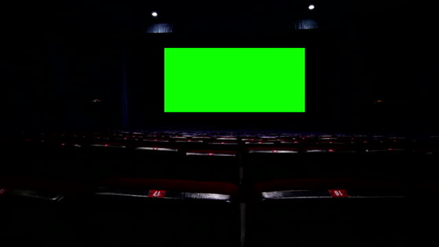 Screen in empty movie theatre