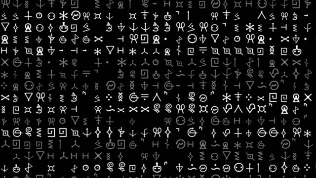A screen of scrolling text, alien letters or code.