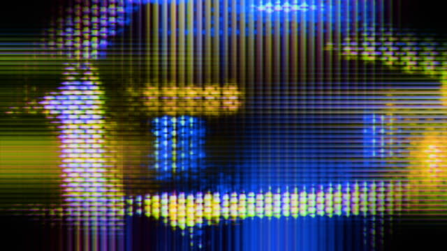 TV screen pixels fluctuate with color and motion.