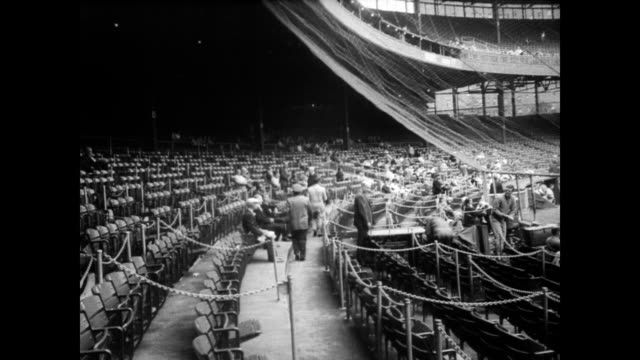 'end of an era last game played at polo grounds' / ws of yankee stadium showing polo grounds just down the street / cu front of polo grounds building... - philadelphia phillies stock-videos und b-roll-filmmaterial