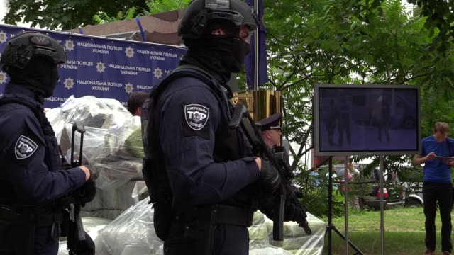 A screen showes a video of detention of drug traffickers during a pess conference of the leadership of the National Police and the AntiNarcotic...