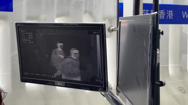 screen shows a thermographic image of people walking through a temperature screening point at an entrance to hong kong international airport in hong... - thermal imaging stock videos & royalty-free footage