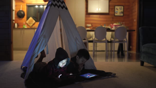 screen time for kids at home. - tent stock videos & royalty-free footage