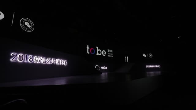 Screens on stage display promotional graphics at the WeChat Open Class Pro conference in Guangzhou China on Monday Jan 15 Allen Zhang senior...