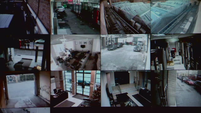 vídeos de stock e filmes b-roll de cu screens showing various views from security cameras / london, england - vigilância