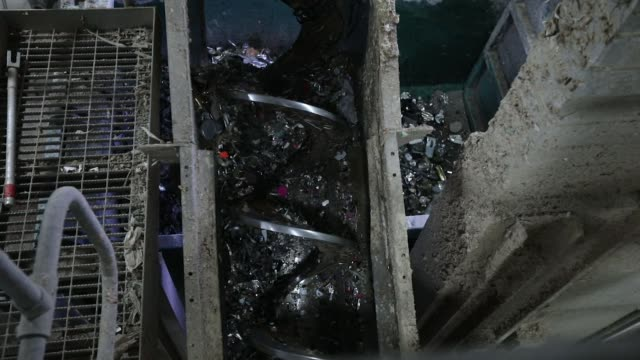 a screw machine separates out metals mixed in with recyalced cardboard in the machine house at the townsend hook paper mill operated by smurfit kappa... - paper mill stock videos and b-roll footage