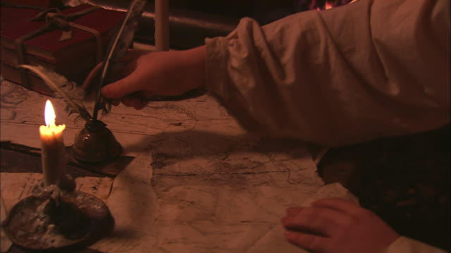 a scribe adds details to a map. - the past stock videos and b-roll footage