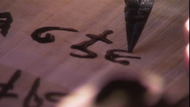 a scribe writes symbols on papyrus. - north africa stock videos & royalty-free footage