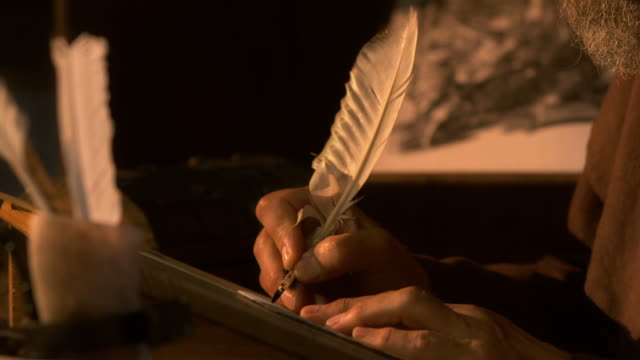 hd: scribing ancient text with a quill pen - monk stock videos & royalty-free footage