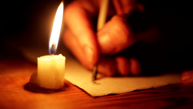 scribing ancient text with a quill pen - candle stock videos & royalty-free footage