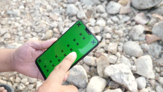 scrolling smart phone with green screen mock-up in camping area with rocky beach - web page stock videos & royalty-free footage