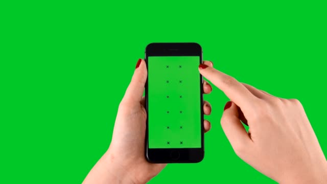 scrolling up and down smart phone displaying chroma key on green screen - tapping stock videos & royalty-free footage