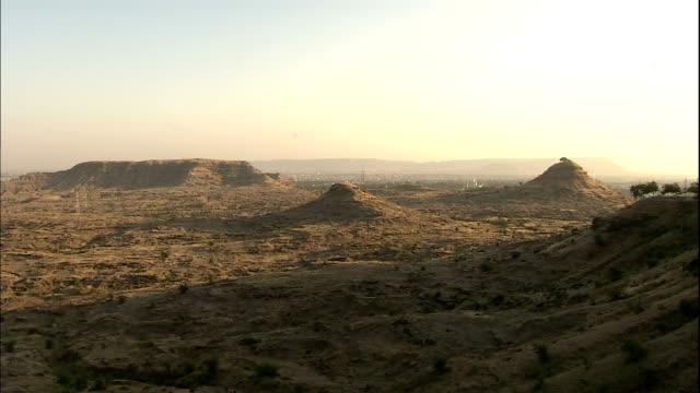 Scrub brush dots the arid Deccan Plateau.