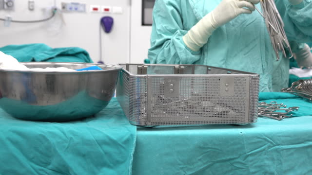 scrub nurse preparing surgical instruments for operation - tray stock videos and b-roll footage