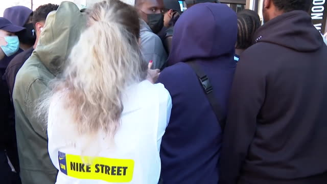 scrum of people outside nike store in london as shoppers are keen to get inside as clothes shops reopen in england as coronavirus lockdown... - effort stock videos & royalty-free footage