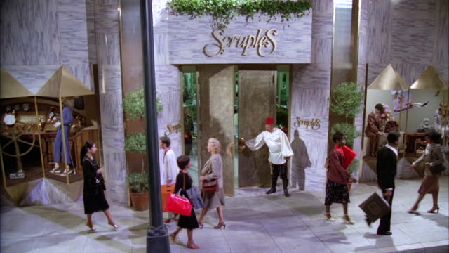 ms zi  scruples entrance with doorman people enter and exit elegant department store / unspecified - department store stock videos and b-roll footage