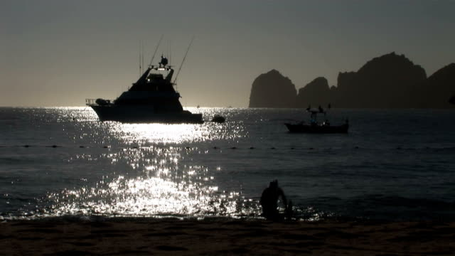 scuba diver coming out of ocean in cabo's sunset - cabo san lucas stock videos and b-roll footage